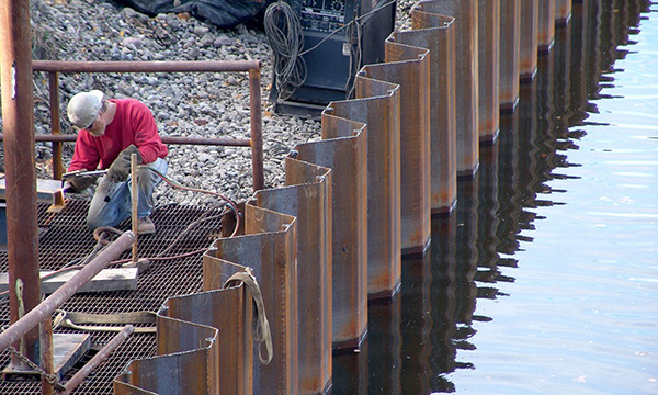 Optimum design of sheet pile walls