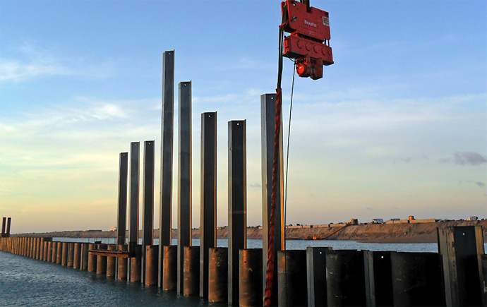 Sheet pile with vibratory hammers