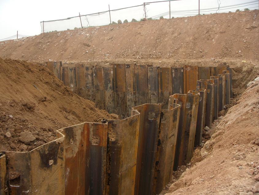 Sheet piles retains soil with interlocking edges